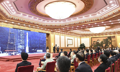 Officials attending the completion and commissioning ceremony for the Beidou Navigation Satellite System at the Great Hall of the People in Beijing, China.